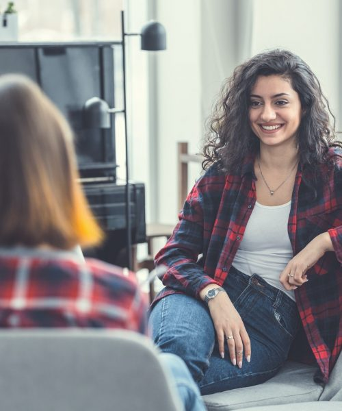 Smiling girls at meeting